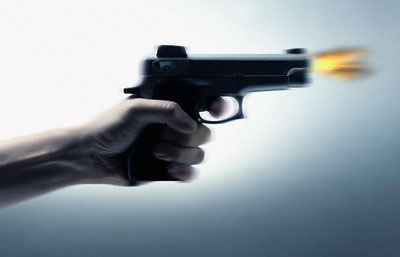 Hand Firing Gun --- Image by © Royalty-Free/Corbis