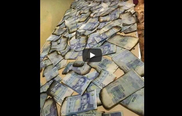 """فيديو ..احتراق حقيبة تحتوي على أكثر من 20 مليون سنتيم بأحد محلات سوق """" إنزكان """""""