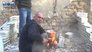 سوري محاصر يجبره الجوع على أكل قطة